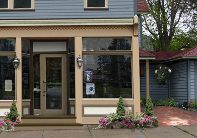 With a little help from Photoshop, I've taken a shot at illustrating how the storefront at 72 Conkey Avenue could look if the City gave local resident Jim Fraser a chance to apply his skills and vision to the property. [Illustration: Mike Governale]