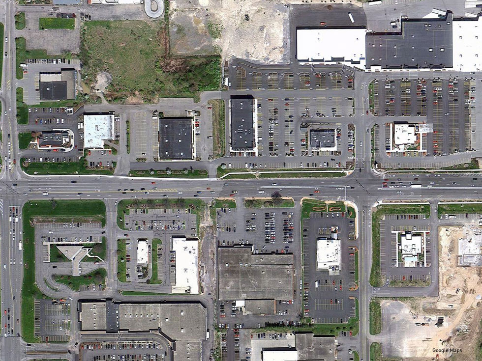 Satellite image of a section of Jefferson Road in Henrietta, NY. Places designed around the automobile.