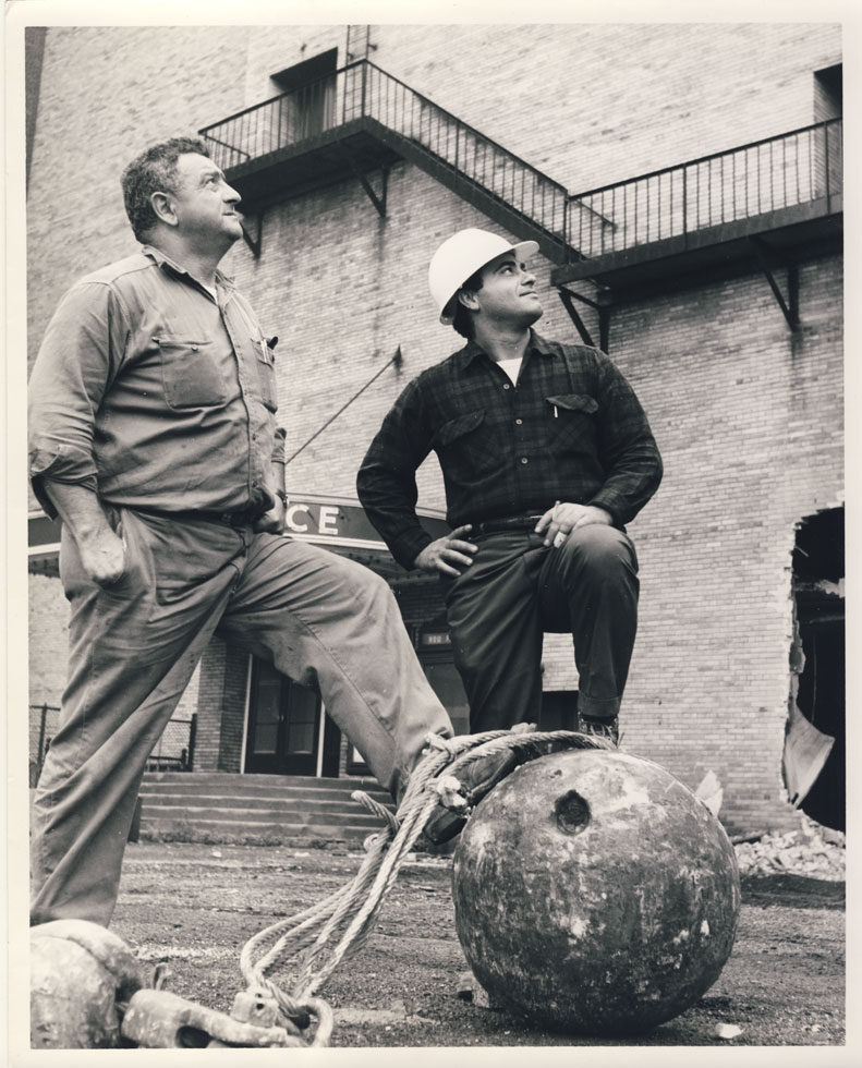 Two of the crew and wrecking ball which would take down the RKO Palace. [PHOTO: D.O. Schultz / Rochester Theater Organ Society]