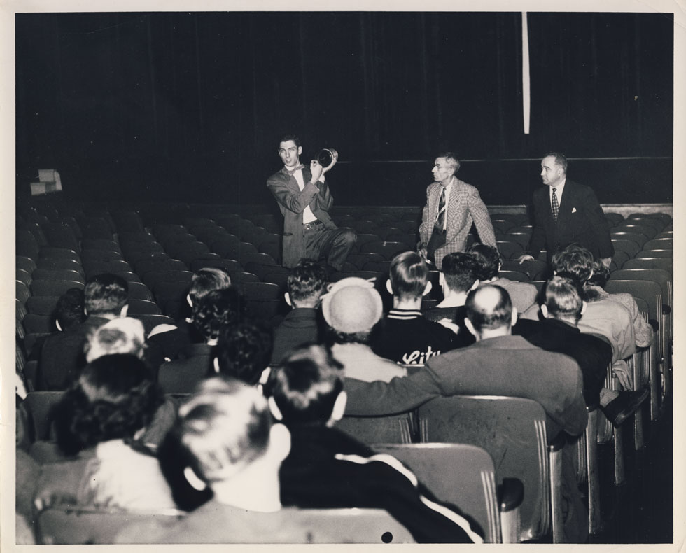 A Bausch & Lomb engineer explains CinemaScope. That's the RKO Palace manager on the right. [PHOTO: D.O. Schultz / Rochester Theater Organ Society]