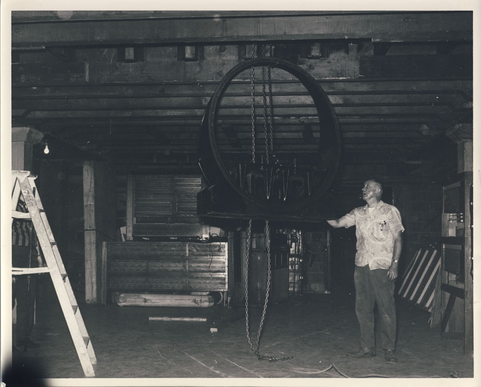Rochester Theater Organ Society member with the organ blower beneath the stage. [PHOTO: D.O. Schultz / Rochester Theater Organ Society]