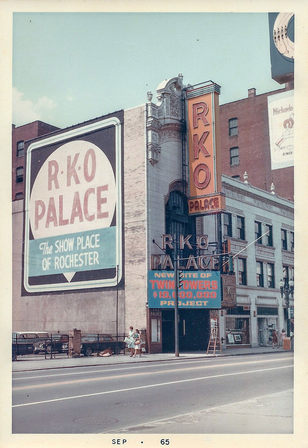 Rochester's RKO Palace Theater, September 1965. A sign is hung on the marquee proclaiming this the site of new $10 Million dollar twin towers. The theater was demolished and no towers were ever built on the site. [PHOTO: Courtesy of Rochester Theater Organ Society]