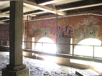 Graffiti over the spillway arches.