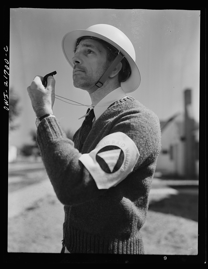 Mr. Babcock is an air raid warden [PHOTO: Library of Congress]