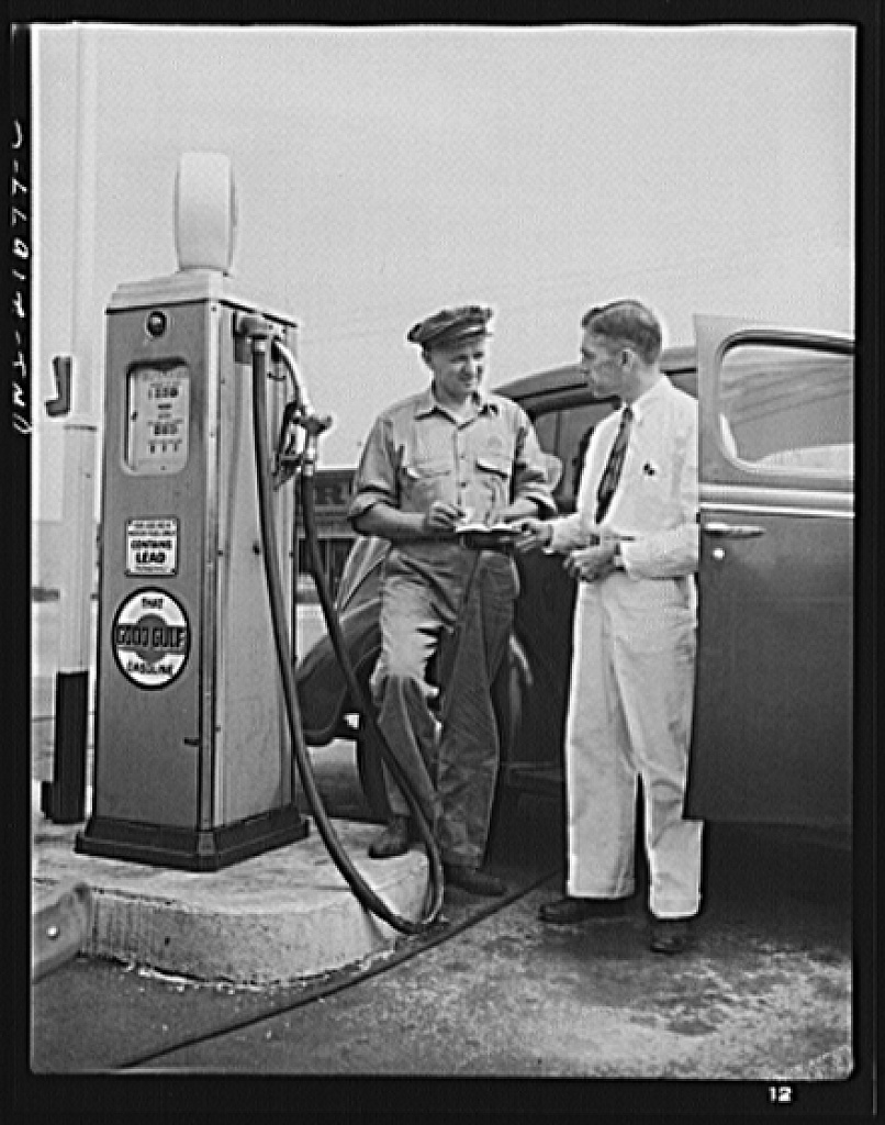 Mr. Babcock explaining an operation to one of the men whom he supervises at the plant [PHOTO: Library of Congress]