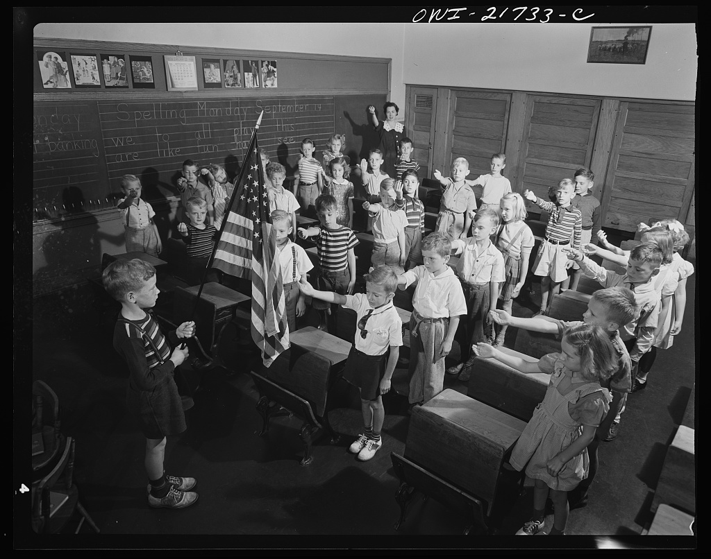 Earl Babcock's school day begins with the salute to the flag [PHOTO: Library of Congress]
