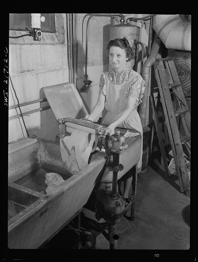 Mrs. Babcock doing the family washing with an electric washing machine and a wringer [PHOTO: Library of Congress]