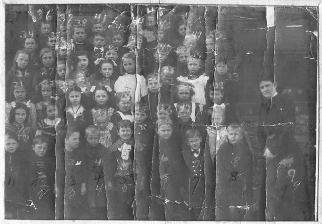 A group portrait of children at Brighton School No. 2, accompanied by their teacher, Kate Lotz (later Mrs. Lays). The school was located at North Avenue (later Winton Road) in Brighton Village. 1902. [PHOTO: Brighton Municipal Historian Collection]