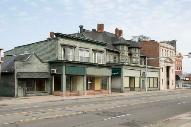 This is a series of pictures taken by Andy Olenick (April, 2011) in an effort to document the buildings before they were torn down. This view, looking northeast, shows the buildings on the north side of East Avenue, including the shuttered businesses of Old Brighton Antiques at 1794 East Ave. and Cyrus Oriental Rugs at 1796. [PHOTO: Andy Olenick, Rochester Public Library]
