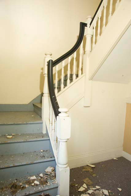 The second floor at 1800-1802 East Avenue. The stairway to attic. [PHOTO: Andy Olenick, Rochester Public Library]