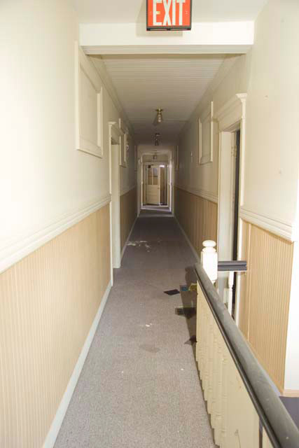 The hallway of 1800-1802 East Avenue. [PHOTO: Andy Olenick, Rochester Public Library]
