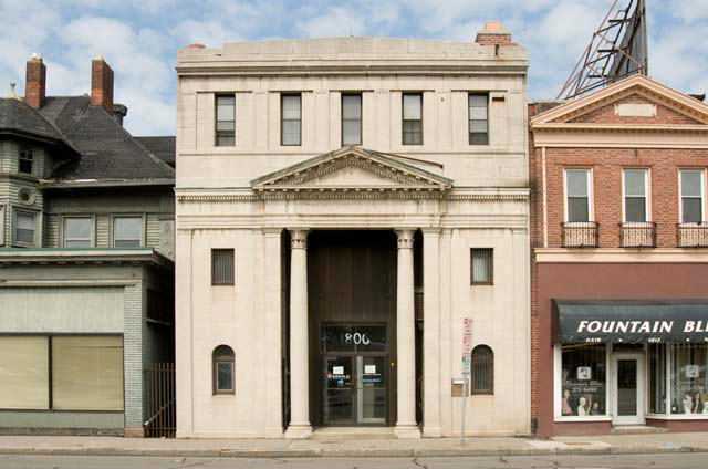 The building which formerly housed Safelink Supply and Upstate New York Alarm. The building once housed a bank. [PHOTO: Andy Olenick, Rochester Public Library]