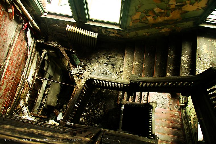 A partially collapsed stairwell in the former Bethlehem Steel North Office Building, Lackawanna, NY. [Photo: Kendall Anderson, Invisiblethreads.com]