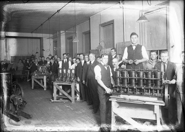 Man assembling engines at the Cunningham Automobile Factory. c.1910-1916. [PHOTO: Albert R. Stone collection]