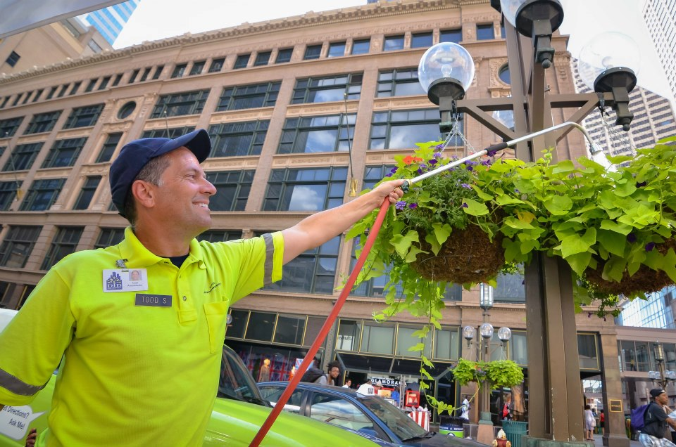 Ambassadors with the Minneapolis Downtown Improvement District provide a variety of services including street cleaning and beautification, providing information, and security. [PHOTO: MinneapolisDID.com]
