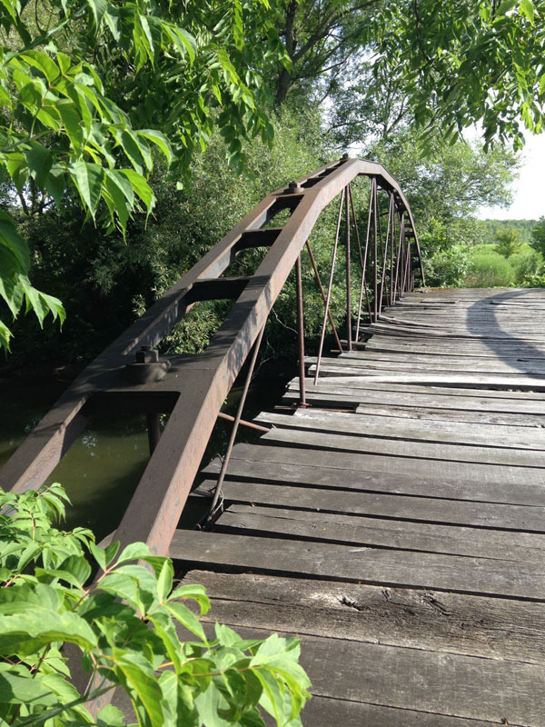 In 1905, the Erie Canal was widened (and renamed to be the New York State Barge Canal) and this bridge was far too short to still be useful. [PHOTO: Chris Clemens]