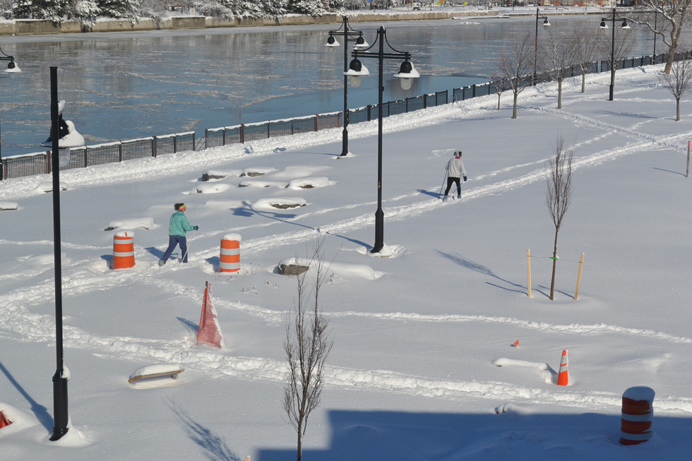 Looking out onto the Genesee Riverway Trail from the apartment. Cross country skiers taking advantage of the conditions. Landscaping will be finished this spring. [PHOTO: RochesterSubway.com]