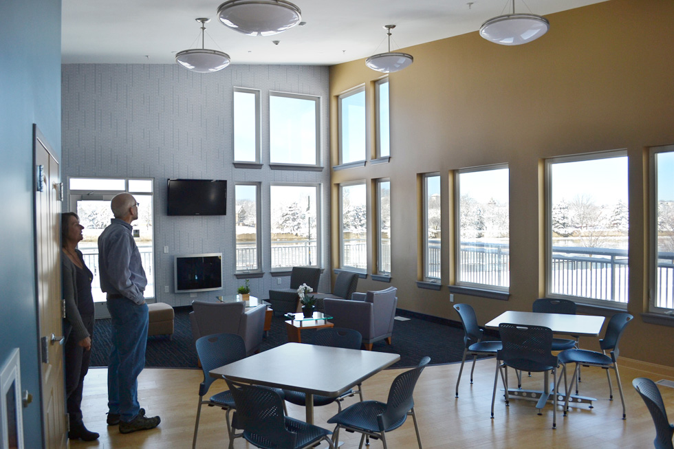The community room also has a flat screen T.V., a little gas fireplace, a kitchen, and a huge deck wrapped around the outside. [PHOTO: RochesterSubway.com]