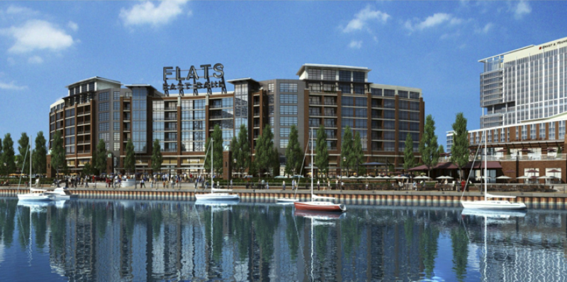 These lots would easily support a building shaped like the Flats East Bank development in Cleveland. Parking would be provided on the first and second floors, with commercial space fronting Lake.