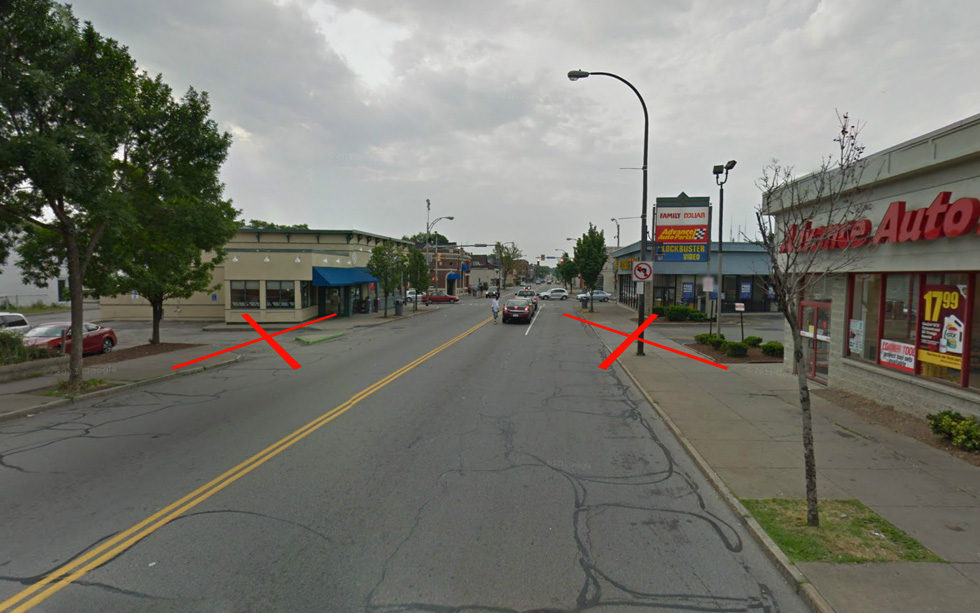 Unnecessary driveways off of Monroe should be removed where ever possible. [IMAGE: Google Streetview]