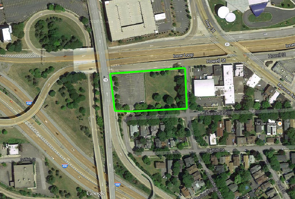 We wouldn't be filling in the green space, just the parking lot adjacent to it. About a 149x183 foot lot.