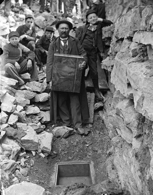 Nick Brayer preparing to lay a time capsule under Front Street, Rochester. 1893. [PHOTO: Rochester Municipal Archives]