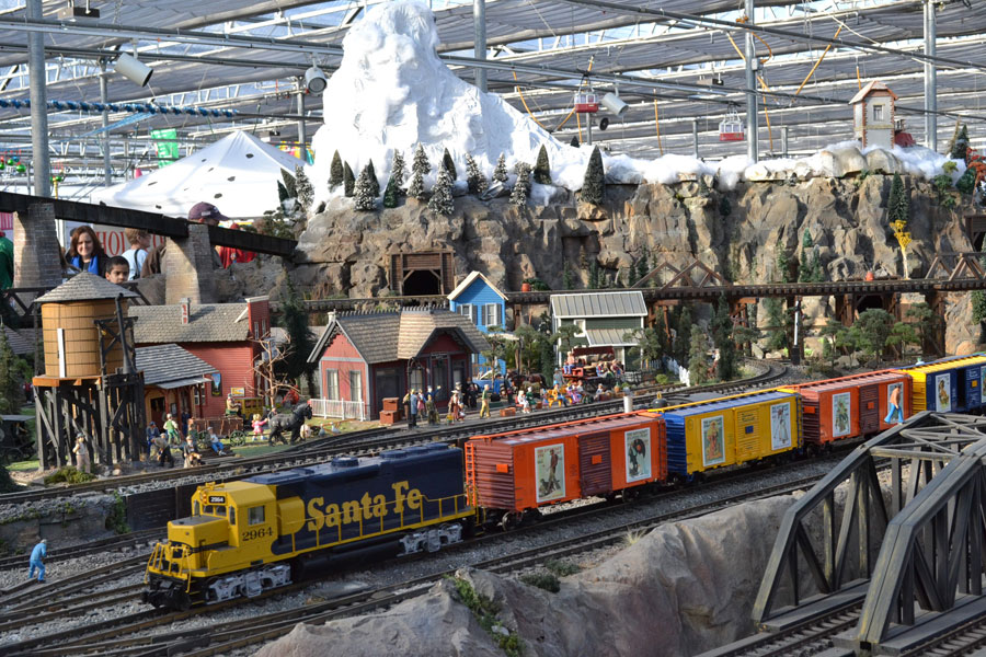 This model railroad display at the Garden Factory features three trolleys and four loooong trains; over 100 train cars in all.