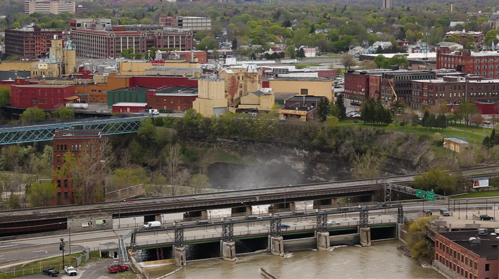 13 Cataract as seen from First Federal Plaza in Downtown Rochester. Mist from High Falls can be seen in the foreground. The big brick building behind the Genesee Brewery sign is the old headquarters of Bausch & Lomb. [PHOTO: Crystal Pix, Inc.]