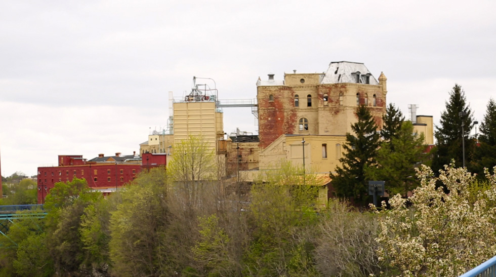 The back side of 13 Cataract Street as seen from a viewing platform near High Falls overlook. [PHOTO: Crystal Pix, Inc.]