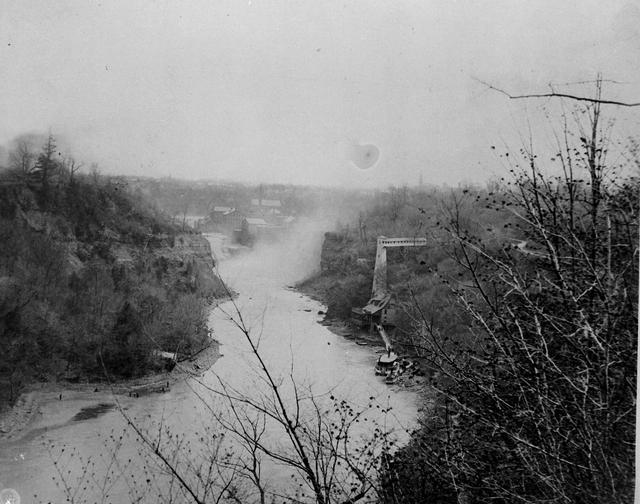 A view of the Genesee River, looking south towards the Glen House, a resort just north of the Lower Falls. The elevator shown was used to carry Glen House patrons to and from the top of the river gorge.  [PHOTO: Rochester Public Library]