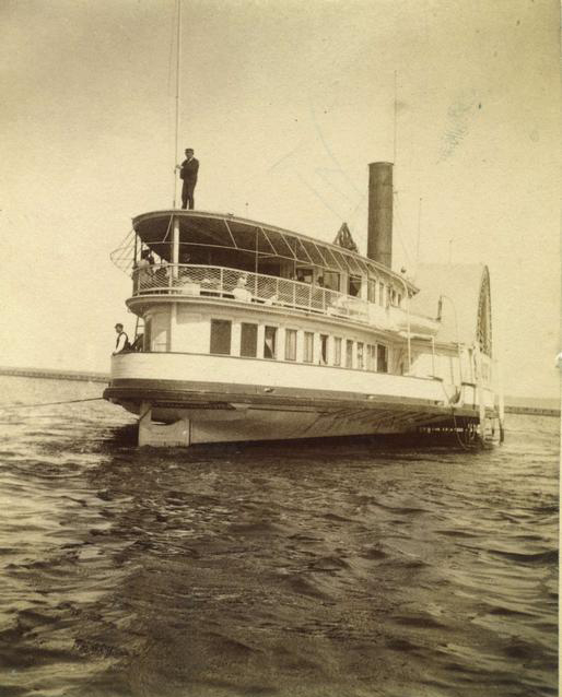 The 'Sylvan Stream' sidewheeler steamboat, seen in the harbor at Charlotte. It was owned by the Rochester and Lake Ontario Steamboat Company, and made daily summer trips between the Glen House and Charlotte. It could carry 800 passengers. c.1886-1894. [PHOTO: Rochester Public Library]