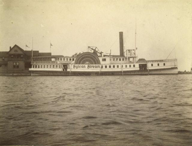 A side view of the 'Sylvan Stream', a sidewheeler steamboat owned by the Rochester and Lake Ontario Steamboat Company. It made daily summer trips between the Glen House and Charlotte. It could carry 800 passengers. c.1886-1894.  [PHOTO: Rochester Public Library]