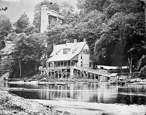 The Glen House stood between the river gorge cliff and the riverbank. When it was built in 1870, patrons had to reach it down approximately 150 steps. The tower and elevator were built in 1878. c.1878-1894. [PHOTO: Albert R. Stone]