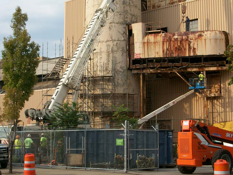 Scaffolding going up around the last RG&E Beebee Power Station smoke stack, High Falls. [PHOTO: RochesterSubway.com]