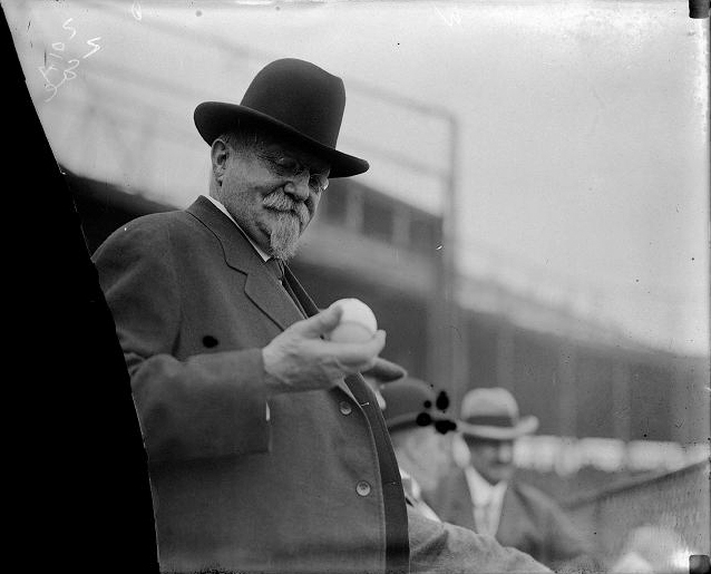 Rochester's Mayor Hiram Edgerton inspecting a baseball at the opening game, May 7, 1912. [PHOTO: Albert R. Stone]