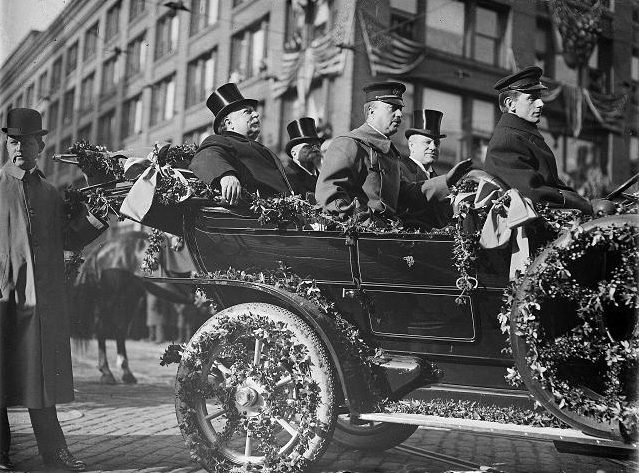 President William Taft arriving in Rochester for his visit to the National GAR Encampment. He is riding from the train station to Hotel Seneca. Taft is in the back seat on the left. Next to him is Mayor Hiram Edgerton. In the front seat are Archibald Butt, the president's personal military aide, and George Dietrich, president of the chamber of commerce. March 18, 1910. [PHOTO: Albert R. Stone]