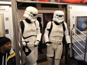 Stormtroopers invade a NYC subway car.