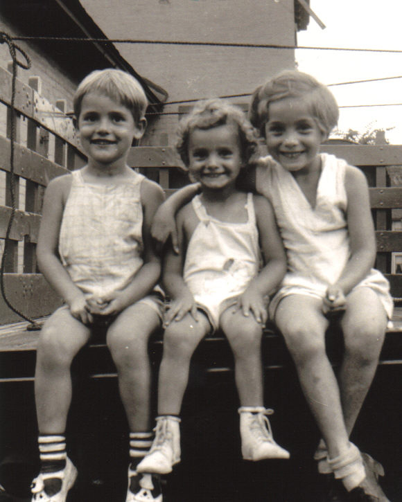 Beverly Ferguson (center), Jean Bissiett (right), and their brother Bob (left). On the roof of Iola (c.1939). [PHOTO COURTESY OF: Mark Hosier]