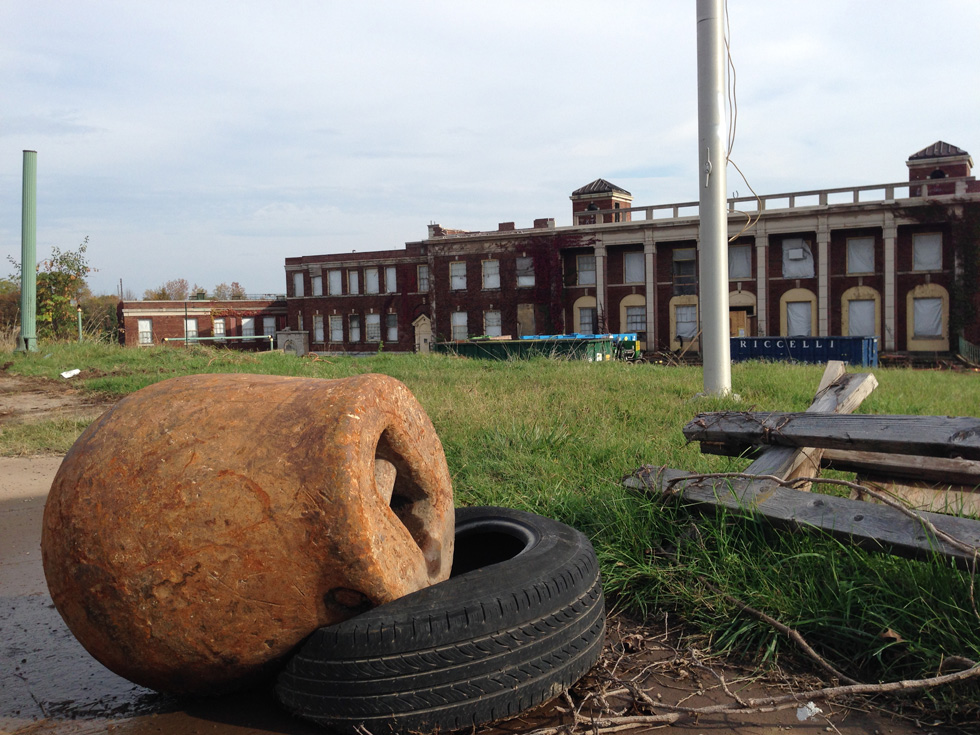 Here the wrecking ball rests on a tire while waiting its job of destroying the Iola main building once the asbestos abatement is complete. [PHOTO: Matt Rieck]