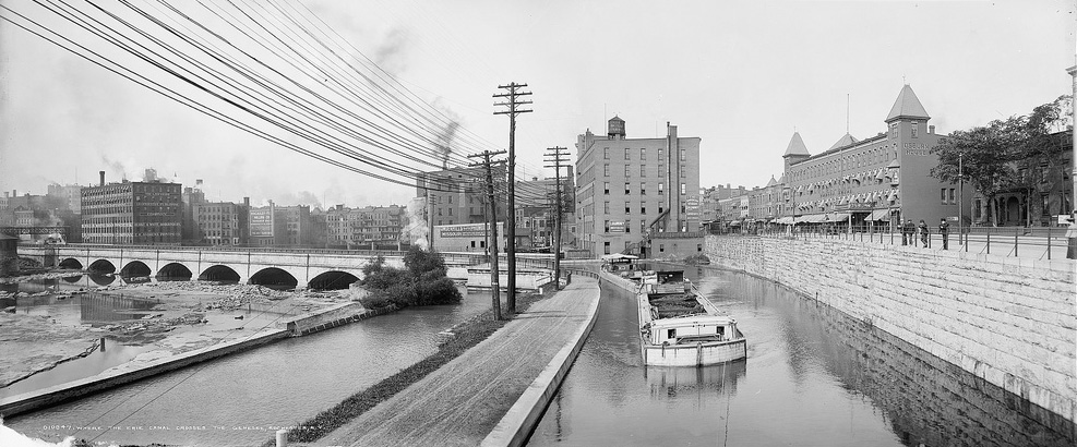 The Johnson Seymour mill race and the Erie Canal, c.1904. The towpath runs between them. In August of 1902, the body of Laura Young, 23, was found in the mill race. The cause of her death remains largely a mystery to this day. [PHOTO: Library of Congress]