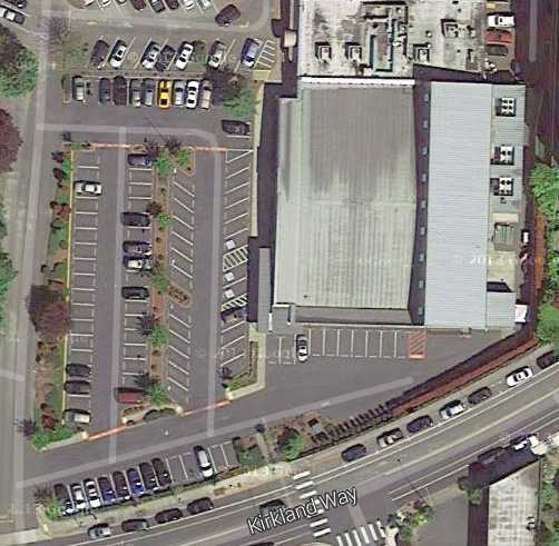 What's on the site right now? A 1-story office building with a much larger parking lot!