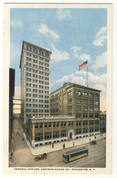 A postcard showing how Kodak Tower looked originally with 16 stories and a flat roof. This view shows an early building in front of the tower, designed around 1899 by renowned local architect J. Foster Warner. Unfortunately this building was razed in the 1950s.