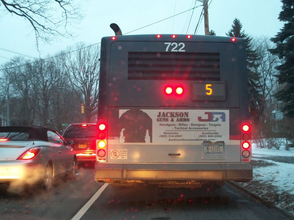 An ad for guns and ammo on the back of an RTS bus. February 1, 2013. [PHOTO: RochesterSubway.com]