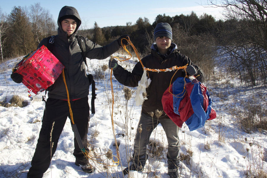 Mathew Ho and Asad Muhammad are too young to vote, or buy beer (even in Canada). But they somehow managed to send a man into space. That's the little guy there on the left attached to the camera box. [PHOTO: via Toronto Star]