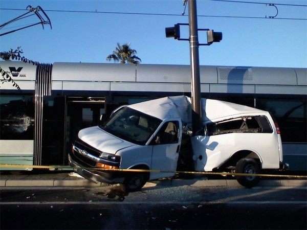 A light rail commuter train crushes a passenger van in Phoenix Arizona after the van ran a red crossing signal.