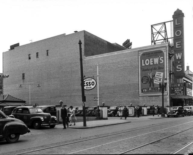 Loew's Theatre, 120 South Clinton Avenue, on the east side of the street north of Court Street. A car parking lot is next to the theater. May 5, 1941. [PHOTO: Rochester Municipal Archives]