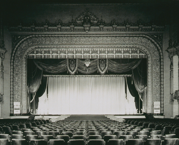 Main Floor & Stage. 1940. With over 3,500 seats it was advertised as the largest theater in America between New York and Chicago. The auditorium featured bronze light fixtures, murals, leather upholstery for the box seats, and an enormous Marr & Colton organ. [PHOTO: Ossie Wieggel / George Eastman House]
