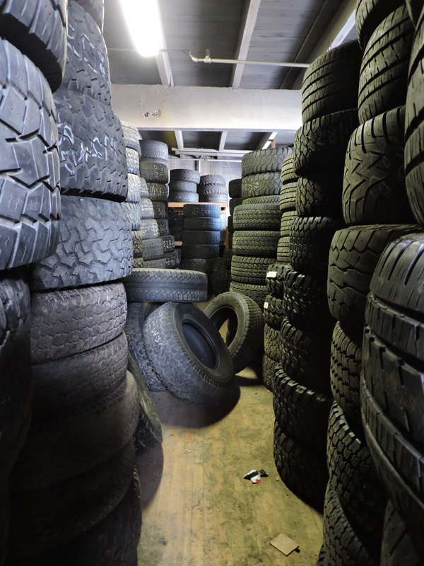 There are literally tires EVERYWHERE in this place. Every office, every room and packed to the rafters. [PHOTO: Joanne Brokaw]