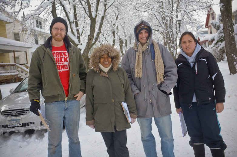 On Saturday, February 6, the day after a snow storm, 16 canvassers joined Mary to visit her neighbors with her petition. [PHOTO: Julie Gelfand]