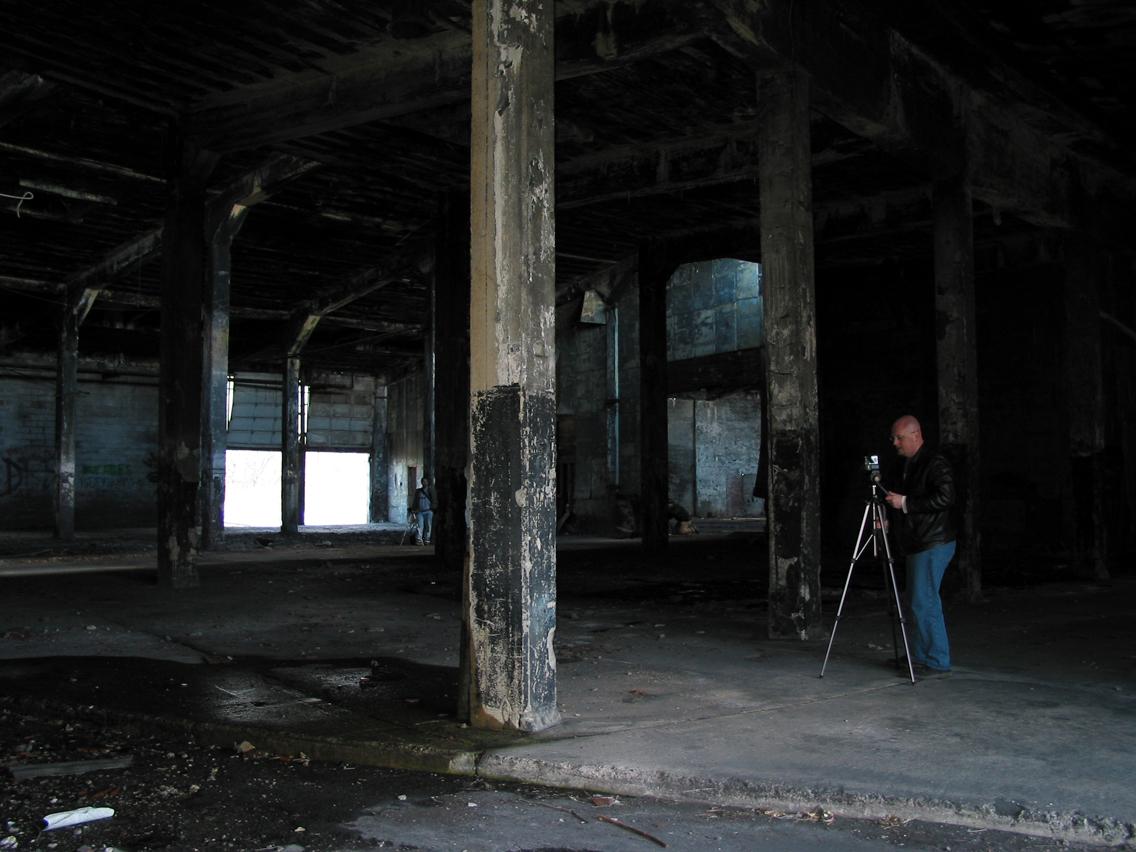 Chris Luckhardt shooting inside an abandoned train yard warehouse in Manchester, NY. (photo: Chris Luckhardt)